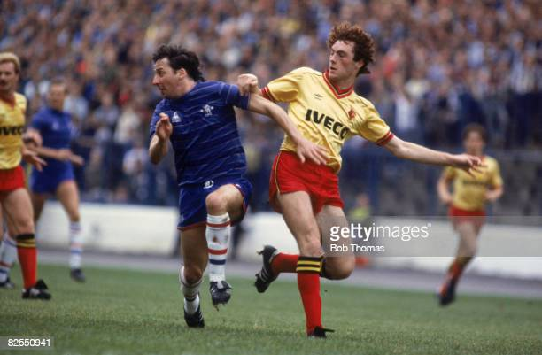 Welsh footballer Mickey Thomas of Chelsea clashes with Watford's David Bardsley during a Division One match 13th October 1984 Watford won 23