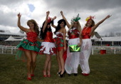 Welsh girls pose for the camera on Ladies Day at Aintree racecourse on April 05 2013 in Liverpool England