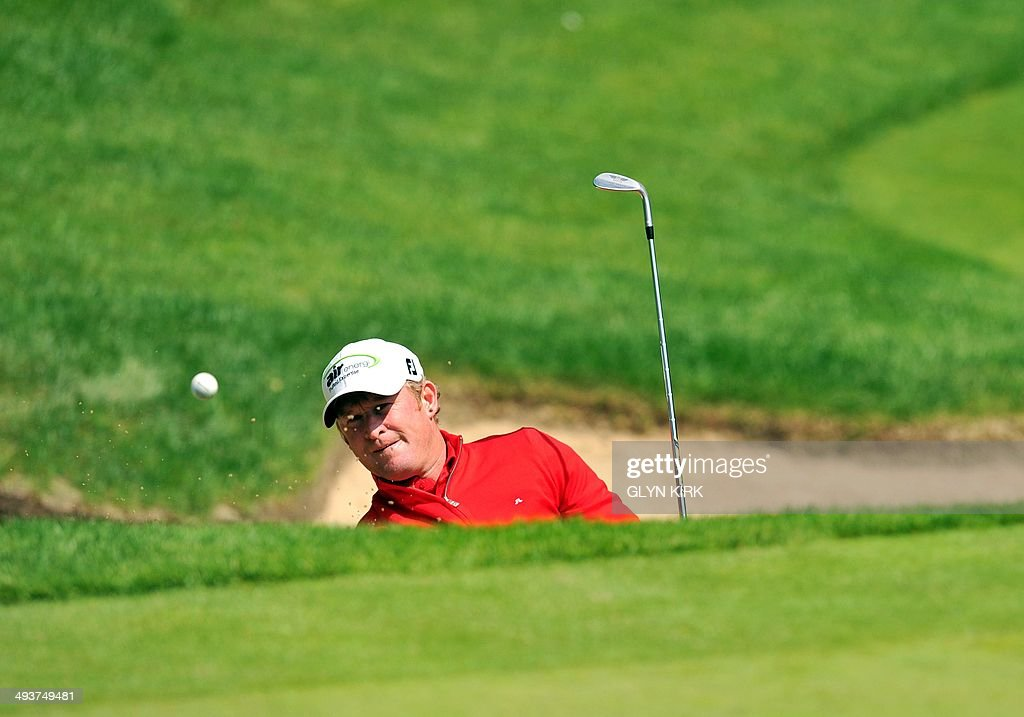 Welsh golfer Jamie Donaldson plays from a bunker at the 3rd green during the final round of the PGA Championship at Wentworth Golf Club in Surrey, England, on May 25, 2014.