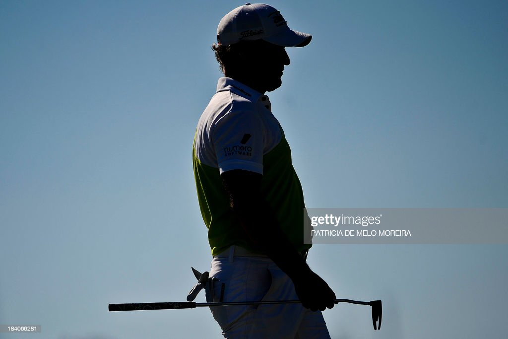 Welsh golfer Jamie Donaldson stands at the green of the 9th during the second day of the Portugal Masters golf tournament at Victoria Golf Course in Vilamoura, southern Portugal on October 11, 2013.