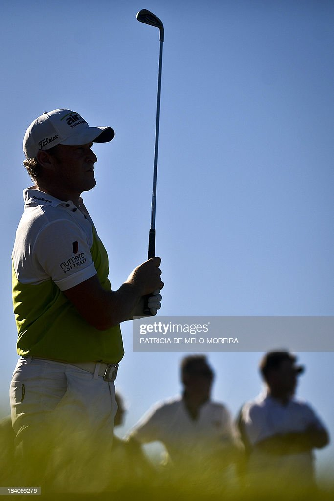 Welsh golfer Jamie Donaldson tees off to the 13th hole during the second day of the Portugal Masters golf tournament at Victoria Golf Course in Vilamoura, southern Portugal on October 11, 2013.