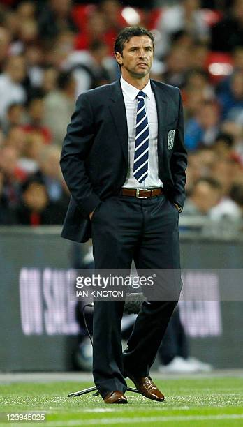 Welsh manager Gary Speed watches his team play against England in their 2012 Group G Euro Qualifier football match at Wembley stadium in London on...
