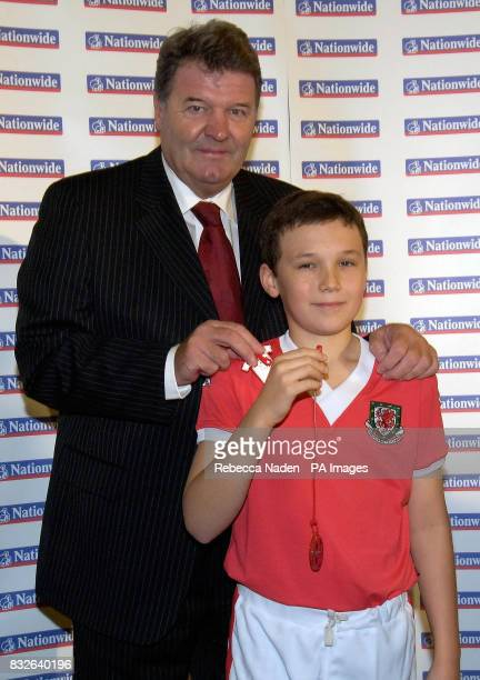Welsh manager John Toshack with Alex Adams during the launch of the 'Cats Eyes For Kids' scheme at St George's Primary School London