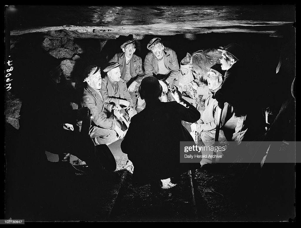 Welsh miners singing carols 1943 A photograph of a group of miners singing Christmas carols underground at the Bryn Varteg Colliery Ystradgynlais...