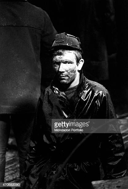 'A Welsh miners wearing a helmet and his face filthy with mud after the landslide that devastated his village on the 21st October Aberfan October...