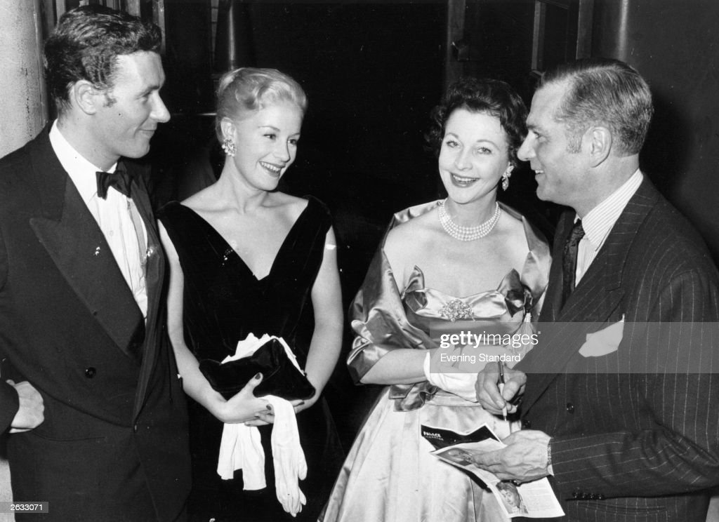 Welsh playwright John Osborne (1929 - 1994) with his wife actress Mary Ure (left) chatting with actor Sir Laurence Olivier and his wife actress Vivien Leigh after a performance of Osborne's play 'The Entertainer'. Original Publication: People Disc - HH0189
