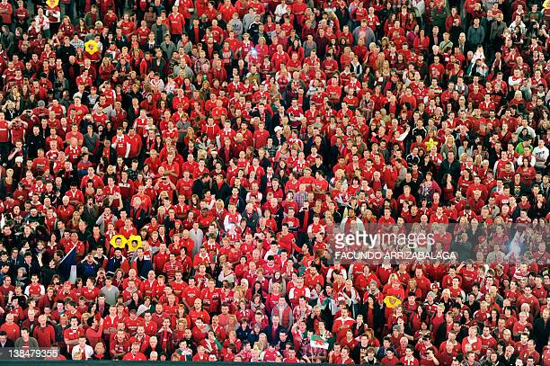 Welsh rugby fans watch the 2011 Rugby World Cup semifinal match Wales vs France on a giant screen at Cardiff's Millennium Stadium on October 15 2011...