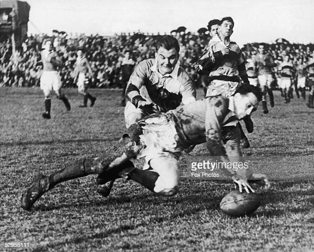 Welsh rugby player Ken Jones scoring a try during a match at Hamilton between the British Rugby Union touring team and the New Zealand Combined 26th...