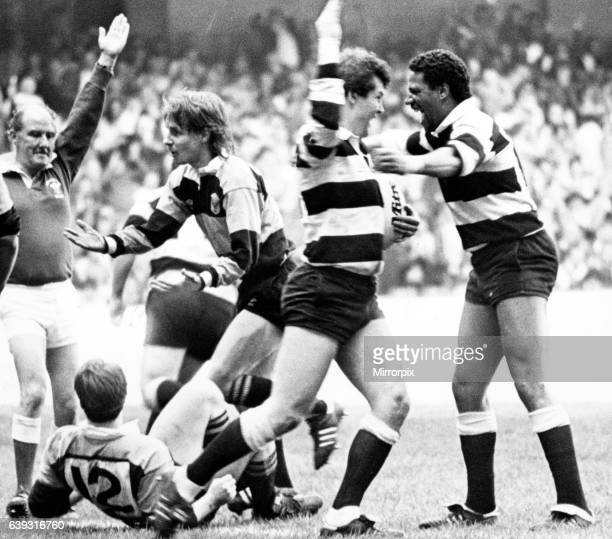 Welsh Rugby Union Final Cardiff 28 21 NewportArms aloft by referee Ken Rowlands and Try Scorer Adrian Hadley of Cardiff say it all as he receives...