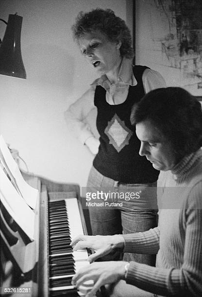 Welsh singer and actress Petula Clark singing to a piano accompaniment by English songwriter producer and arranger Tony Hatch February 1975