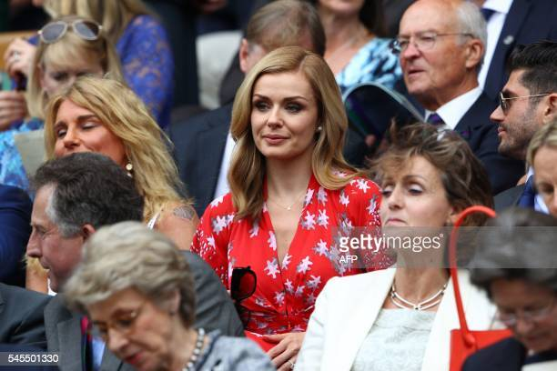 Welsh singer Katherine Jenkins sits in the royal box on centre court during the men's semifinal match between Switzerland's Roger Federer and...