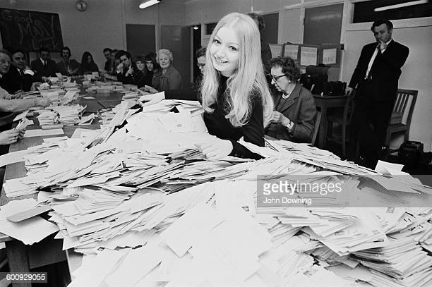 Welsh singer Mary Hopkin sorting postcards at the BBC to decide which song she will sing in the upcoming Eurovision Song Contest London UK 11th March...