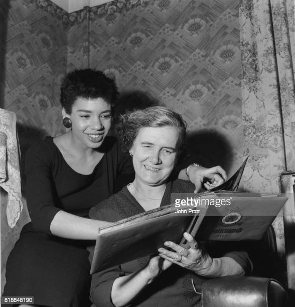 Welsh singer Shirley Bassey at home with her mother Eliza in Tiger Bay Cardiff Wales 1955