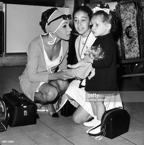 Welsh singer Shirley Bassey at London Airport with her daughters Sharon and Samantha August 1966