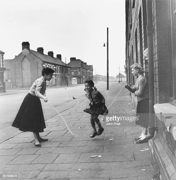 Welsh singer Shirley Bassey joins in a skipping game with members of her family outside their home in the Tiger Bay area of Cardiff Wales 9th...