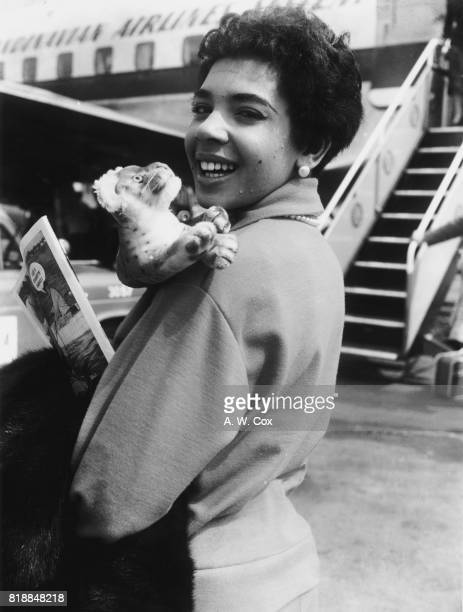 Welsh singer Shirley Bassey leaves London Airport for a series of concerts in Stockholm with her tiger mascot 1st June 1957 She was born in Tiger Bay...