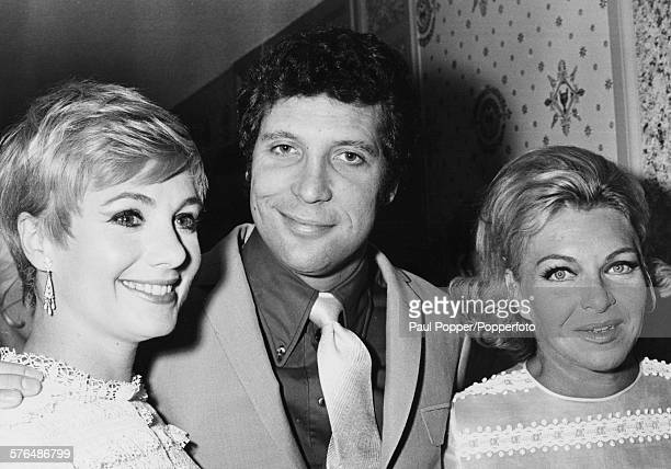 Welsh singer Tom Jones pictured with his arms around fellow singers Shirley Jones and Line Renaud after his performance in Las Vagas Nevada circa 1967