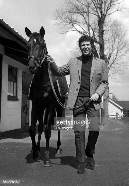 Welsh singer Tom Jones with the racehorse 'Walk On By' which he has just purchased for an undisclosed sum at Brian Swift's stables at Epsom in Surrey...