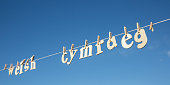 Welsh spelt out on a clothes line with pegs holding the letters