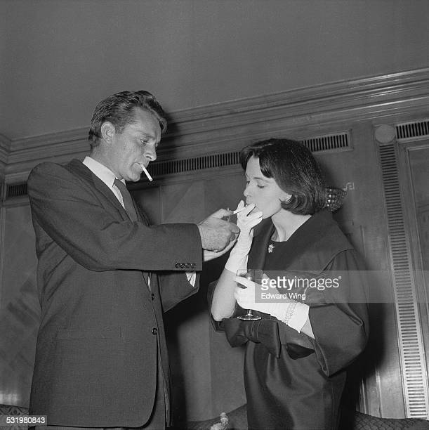 Welsh stage and cinema actor Richard Burton and English film and stage actress Claire Bloom attend a reception at the Dorchester Hotel for their...