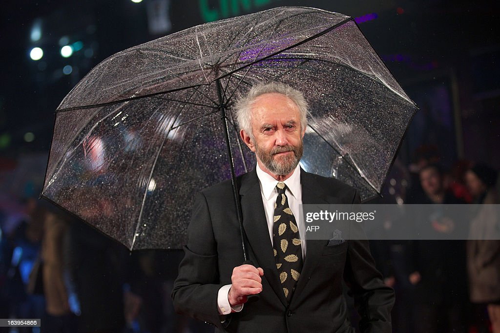 Welsh stage and film actor and singer Jonathan Pryce poses for pictures on the red carpet as he arrives for the 'G I Joe: Retaliation' UK film Premiere in central London on March 18, 2013.