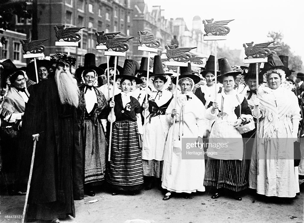 Welsh suffragettes in traditional costume on the Women's Coronation Procession 17th June 1911 They hold standards of the dragon passant which is seen...