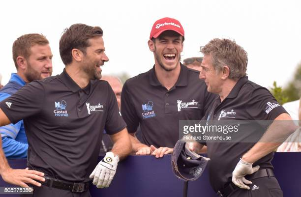 Welsh Team mates Gethin Jones Gareth Bale and Jonathan Davies joke before they play on Day one of the Celebrity Cup at Celtic Manor Resort at Celtic...