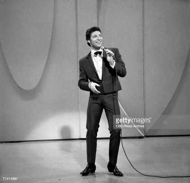 Welshborn popular singer Tom Jones sings as he wears a short jacket on the Ed Sullivan Show New York December 5 1965