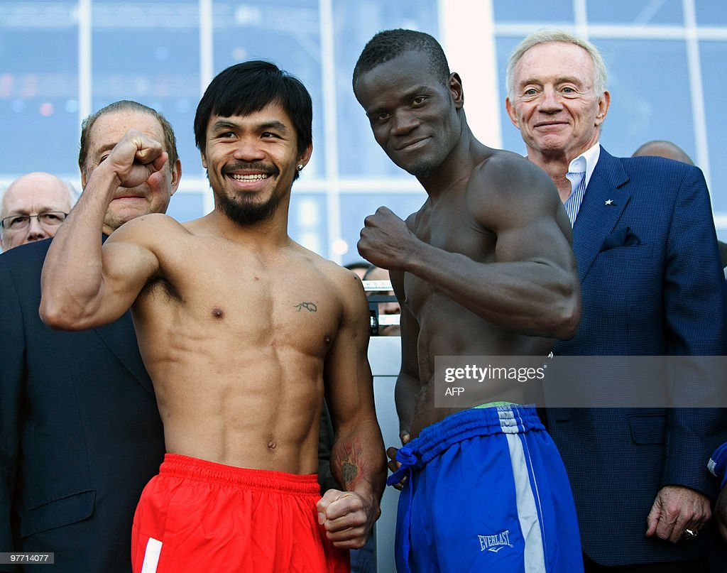 Welterweight boxers Manny Pacquiao of the Philippines and Joshua Clottey of Ghana pose for the press during their weighin at the Dallas Cowboys...