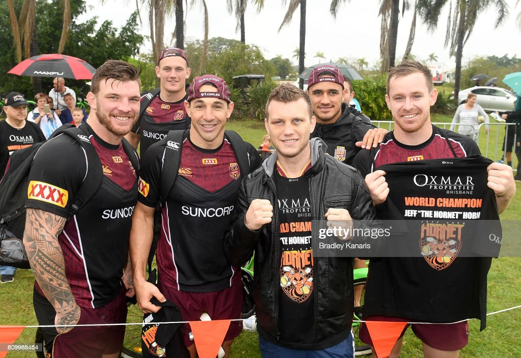 WBO Welterweight Boxing World Champion Jeff Horn poses for a photo with Maroons players Josh McGuire, Coen Hess, Billy Slater, Valentine Holmes and Michael Morgan during a Queensland Maroons State of Origin training session at Sanctuary Cove on July 7, 2017 in Brisbane, Australia.
