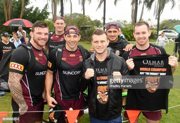 Welterweight Boxing World Champion Jeff Horn poses for a photo with Maroons players Josh McGuire Coen Hess Billy Slater Valentine Holmes and Michael...