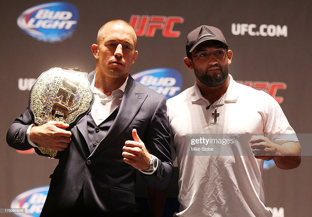 UFC welterweight champion Georges St-Pierre and Johny Hendricks pose for a photo during a press conference at Beacon Theatre on July 31, 2013 in New York City.
