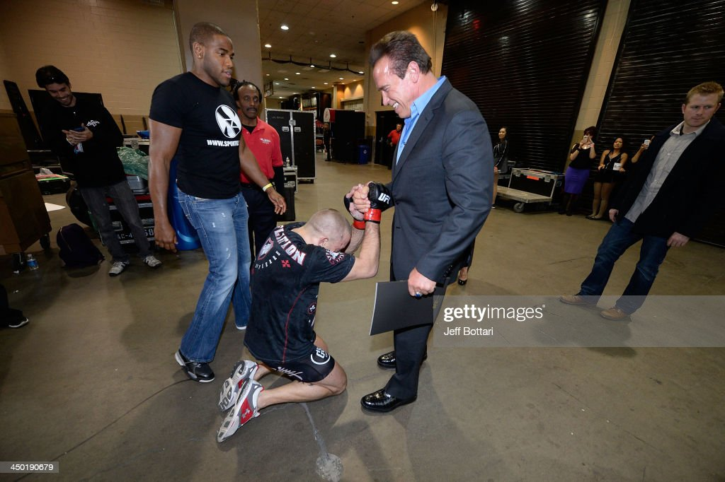 Welterweight Champion <a gi-track='captionPersonalityLinkClicked' href=/galleries/search?phrase=Georges+St-Pierre&family=editorial&specificpeople=4864241 ng-click='$event.stopPropagation()'>Georges St-Pierre</a> (L) greets <a gi-track='captionPersonalityLinkClicked' href=/galleries/search?phrase=Arnold+Schwarzenegger&family=editorial&specificpeople=156406 ng-click='$event.stopPropagation()'>Arnold Schwarzenegger</a> (R) after the UFC 167 event at the MGM Grand Garden Arena on November 16, 2013 in Las Vegas, Nevada. <a gi-track='captionPersonalityLinkClicked' href=/galleries/search?phrase=Georges+St-Pierre&family=editorial&specificpeople=4864241 ng-click='$event.stopPropagation()'>Georges St-Pierre</a> defeated Johny Hendricks by split decision to retain the Welterweight Championship belt.
