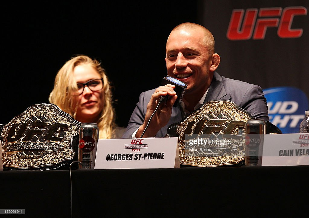 UFC welterweight champion Georges St-Pierre interacts with fans during a press conference at the Beacon Theatre on July 31, 2013 in New York City.