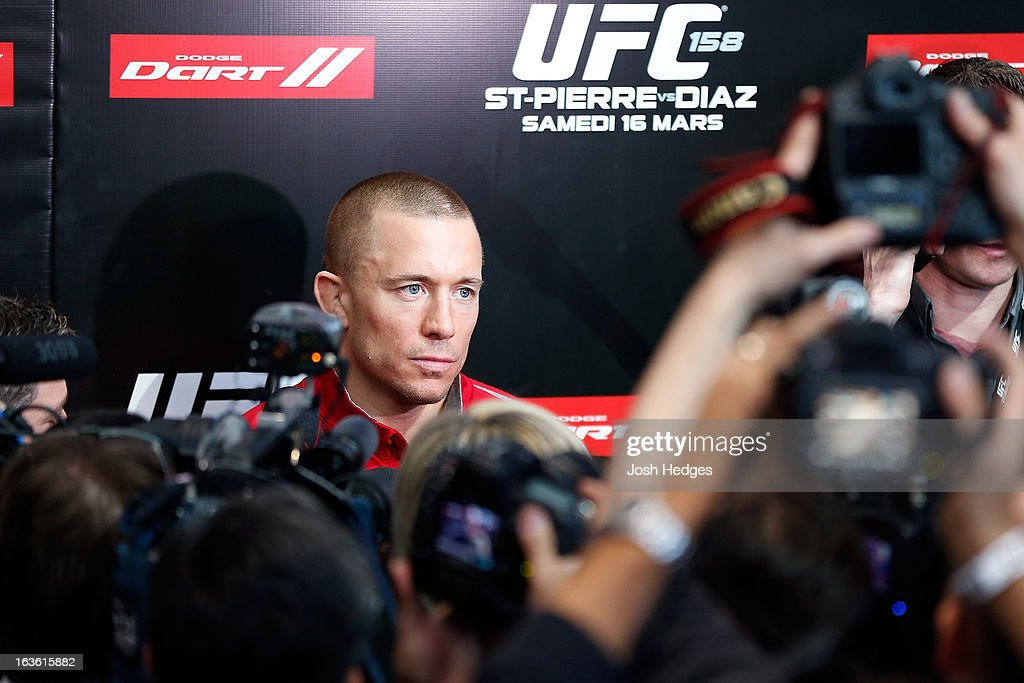 UFC welterweight champion <a gi-track='captionPersonalityLinkClicked' href=/galleries/search?phrase=Georges+St-Pierre&family=editorial&specificpeople=4864241 ng-click='$event.stopPropagation()'>Georges St-Pierre</a> interacts with media during the UFC 158 open workouts at Complexe Desjardins on March 13, 2013 in Montreal, Quebec, Canada.