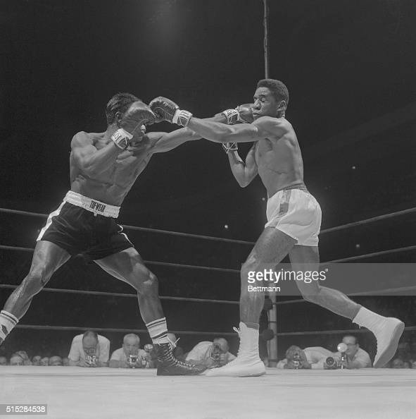 Welterweight champion Luis Rodriguez and former champ Emile Griffith trade left jabs in the first round of their title bout at Madison Square Garden...