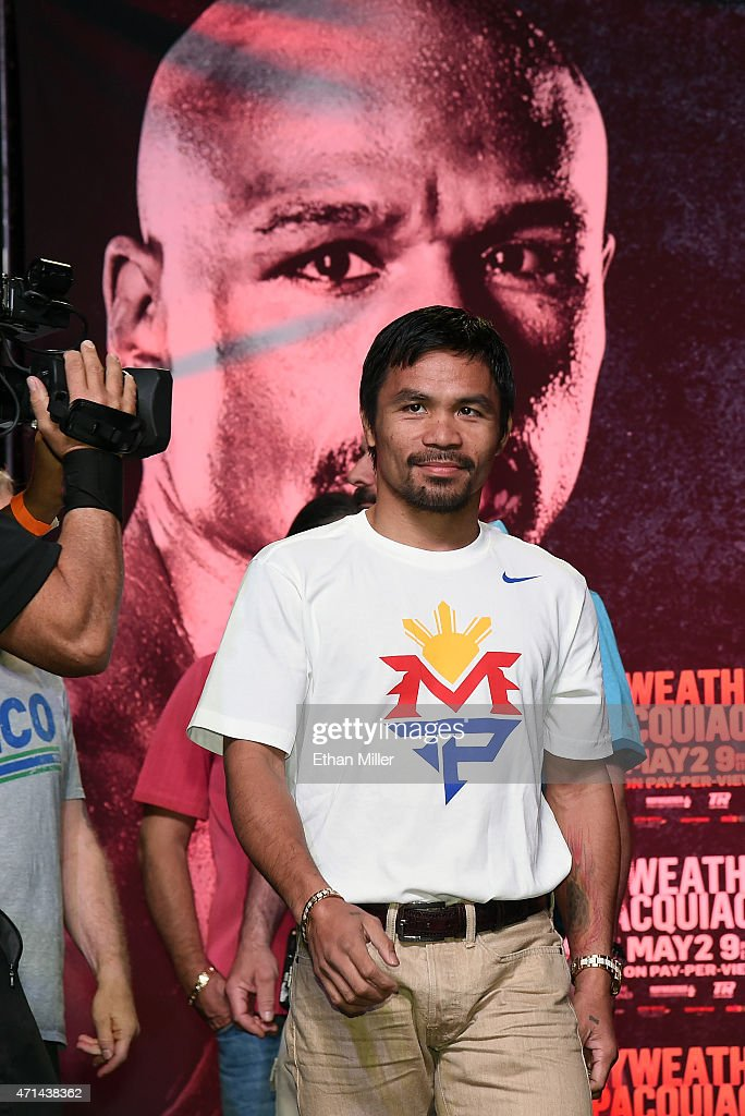 WBO welterweight champion <a gi-track='captionPersonalityLinkClicked' href=/galleries/search?phrase=Manny+Pacquiao&family=editorial&specificpeople=3855506 ng-click='$event.stopPropagation()'>Manny Pacquiao</a> arrives at a fan rally at the Mandalay Bay Convention Center on April 28, 2015 in Las Vegas, Nevada. Pacquiao will face WBC/WBA welterweight champion Floyd Mayweather Jr. in a unification bout on May 2, 2015 in Las Vegas.