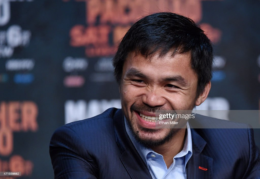 WBO welterweight champion <a gi-track='captionPersonalityLinkClicked' href=/galleries/search?phrase=Manny+Pacquiao&family=editorial&specificpeople=3855506 ng-click='$event.stopPropagation()'>Manny Pacquiao</a> smiles during a news conference at the KA Theatre at MGM Grand Hotel & Casino on April 29, 2015 in Las Vegas, Nevada. Pacquiao will face WBC/WBA welterweight champion Floyd Mayweather Jr. in a unification bout on May 2, 2015 in Las Vegas.