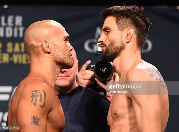 UFC welterweight champion Robbie Lawler and opponent Carlos Condit face off during the UFC 195 weighin at the MGM Grand Conference Center on January...