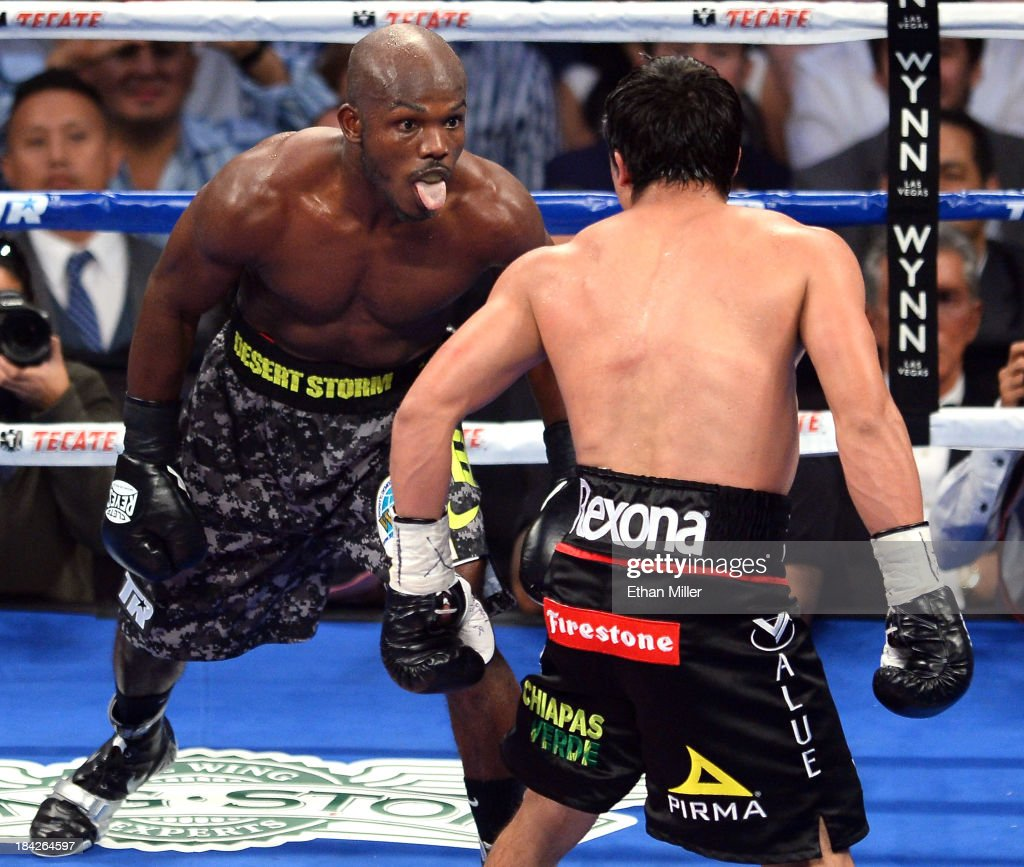 WBO welterweight champion <a gi-track='captionPersonalityLinkClicked' href=/galleries/search?phrase=Timothy+Bradley+-+Boxer&family=editorial&specificpeople=5338349 ng-click='$event.stopPropagation()'>Timothy Bradley</a> Jr. (L) sticks his tongue out at <a gi-track='captionPersonalityLinkClicked' href=/galleries/search?phrase=Juan+Manuel+Marquez&family=editorial&specificpeople=4202669 ng-click='$event.stopPropagation()'>Juan Manuel Marquez</a> in the final seconds of the fifth round of their bout at the Thomas & Mack Center on October 12, 2013 in Las Vegas, Nevada. Bradley won in a split decision.