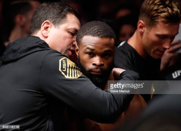 UFC welterweight champion Tyron Woodley listens to a member of his team before entering the Octagon for his fight against Stephen Thompson during UFC...