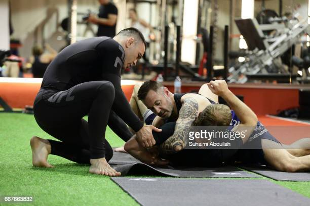 UFC welterweight contender Colby Covington conducts an MMA inspired workouts for fans during the MMA Fan Clinic at UFIT Singapore on April 12 2017 in...