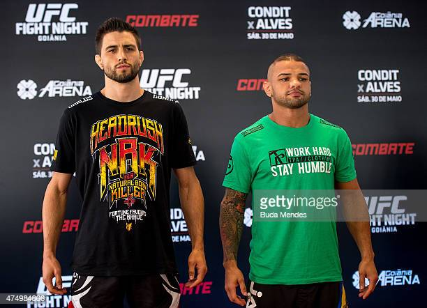 UFC welterweight fighters Carlos Condit of the United States and Thiago Alves of Brazil face off during an open training session for media at Flex...