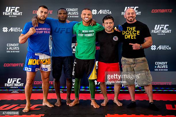 Welterweight Thiago Alves of Brazil poses for a photo with his teammates after an open training session for media at Flex Alphaville Gym on May 28...