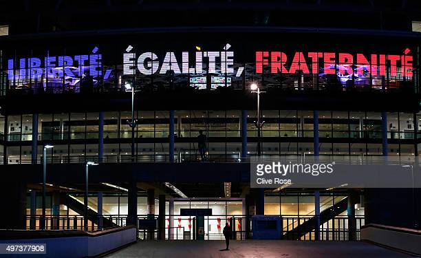 Wembley stadium is lit up in the French Tricolore in remembrance to the victims of last weeks terror attacks in Paris prior to the France training...