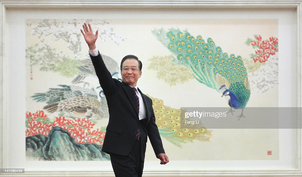 <a gi-track='captionPersonalityLinkClicked' href=/galleries/search?phrase=Wen+Jiabao&family=editorial&specificpeople=204598 ng-click='$event.stopPropagation()'>Wen Jiabao</a>, China's premier, waves as he arrives for a news conference following the close of China's National People's Congress (NPC) at The Great Hall Of The People on March 14, 2012 in Beijing, China. Chinese Premier <a gi-track='captionPersonalityLinkClicked' href=/galleries/search?phrase=Wen+Jiabao&family=editorial&specificpeople=204598 ng-click='$event.stopPropagation()'>Wen Jiabao</a> said on Wednesday that the country will not slacken it efforts in regulating the housing prices, which he considered still 'far from a reasonable level.'