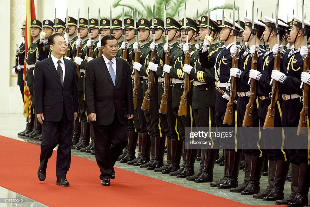 <a gi-track='captionPersonalityLinkClicked' href=/galleries/search?phrase=Wen+Jiabao&family=editorial&specificpeople=204598 ng-click='$event.stopPropagation()'>Wen Jiabao</a>, China's prime minister, left, inspects an honor guard with <a gi-track='captionPersonalityLinkClicked' href=/galleries/search?phrase=Hun+Sen&family=editorial&specificpeople=224084 ng-click='$event.stopPropagation()'>Hun Sen</a>, Cambodia's prime minister, during a welcoming ceremony at the Great Hall of the People in Beijing, China, on Monday, Dec. 13, 2010. <a gi-track='captionPersonalityLinkClicked' href=/galleries/search?phrase=Hun+Sen&family=editorial&specificpeople=224084 ng-click='$event.stopPropagation()'>Hun Sen</a> is visiting China from Dec. 13 - 17. Photographer: Nelson Ching/Bloomberg via Getty Images
