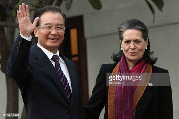 Wen Jiabao China's prime minister left shakes hands with Sonia Gandhi president of the Indian National Congress Party prior to the Indian Council of...