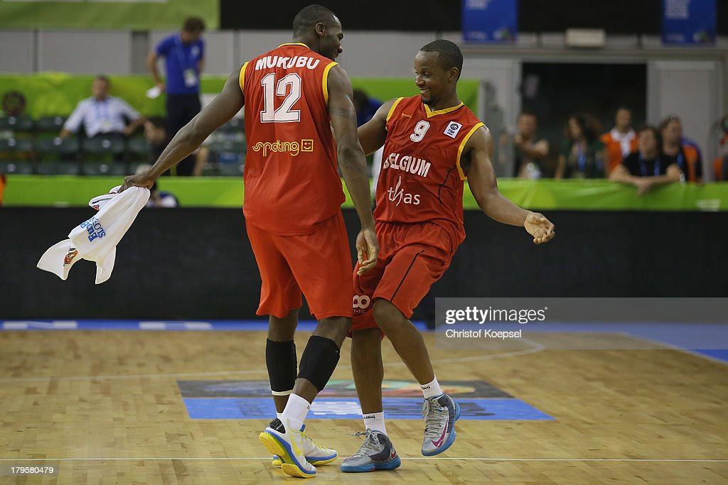 Wen Mukubu and Jonathan Tabu of Belgium celebrate after the FIBA European Championships 2013 first round group A match between Germany and Belgium at Tivoli Arena on September 5, 2013 in Ljubljana, Slovenia. The match between Germany and Belgium ended 73-77 after extra time.