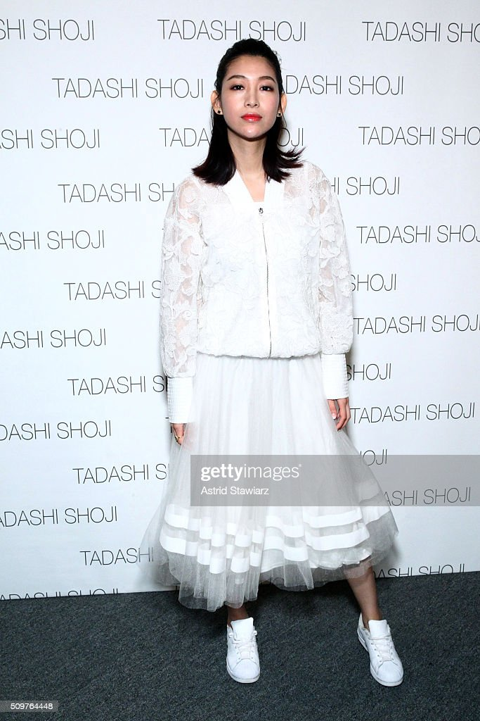 Wen Ya poses backstage at the Tadashi Shoji Fall 2016 fashion show during New York Fashion Week: The Shows at The Arc, Skylight at Moynihan Station on February 12, 2016 in New York City.